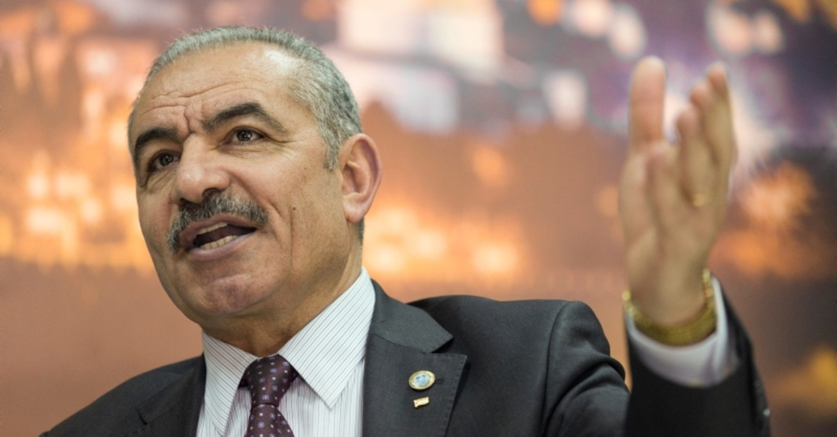In this April 16, 2019 file photo, Palestinian Prime Minister Mohammad Shtayyeh gives an interview with The Associated Press, at his office in the West Bank city of Ramallah. (AP Photo)