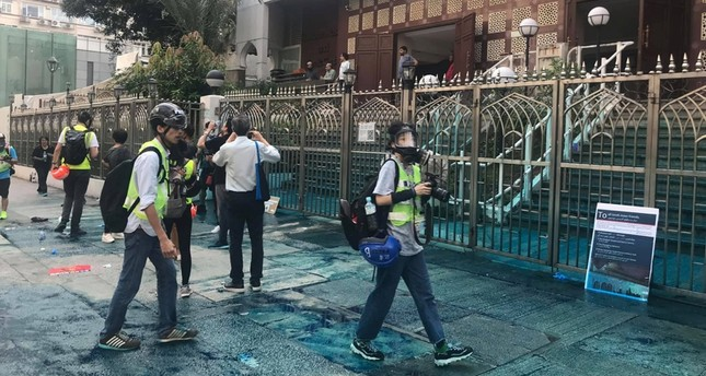 Members of the press are seen outside the Kowloon Masjid and Islamic Centre in Hong Kong, China, after police doused it with a water cannon, on October 20, 2019 in this picture obtained from social media.  (Jeremy Tam/Civic Party via Reuters Photo)