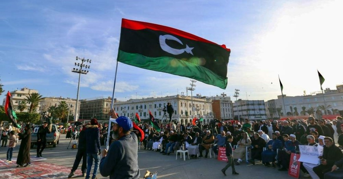 Libyans take part in a demonstration against putschist Gen. Khalifa Haftar, and in support of the UN-recognised government of national accord (GNA), in the Martyrs' Square in the GNA-held capital Tripoli, Jan. 24, 2020. (AFP Photo)