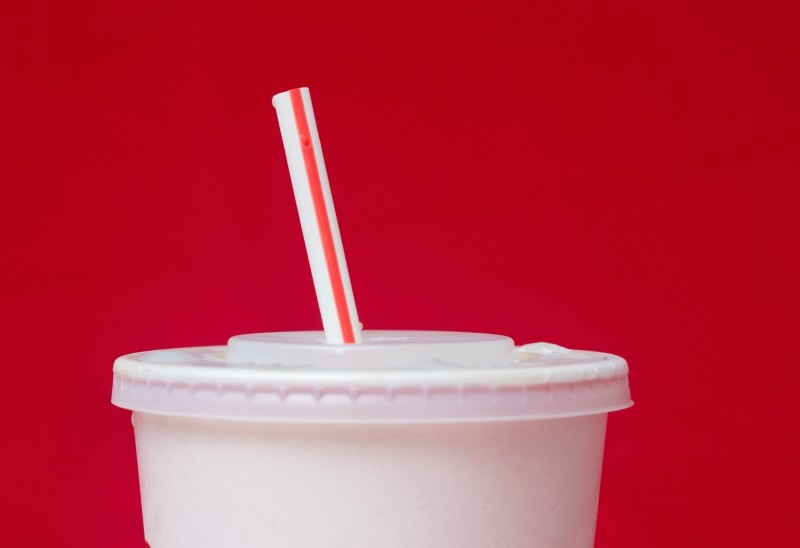 In this May 24, 2018, file photo, a large soft drink with a plastic straw from a McDonald's restaurant is shown in Surfside, Fla. (AP Photo)