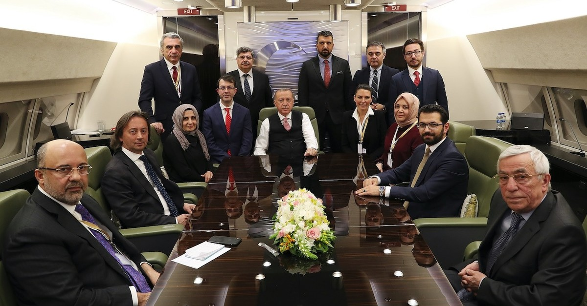 President Recep Tayyip Erdou011fan accompanied by journalists on the presidential plane returning from Russia, April 9, 2019.