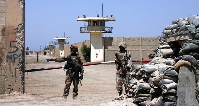 In this Sept. 2, 2006, file photo, Iraqi army soldiers stand guard at the Abu Ghraib prison, after taking over from U.S. soldiers, on the outskirts of Baghdad, Iraq. AP Photo