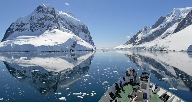 A small cruise ship passes through the Lemaire Channel in Antarctica. (FILE Photo)