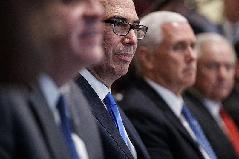 U.S. Secretary of Treasury Steve Mnuchin listens as US President Donald J. Trump delivers remarks during a Cabinet meeting in the Cabinet Room of the White House in Washington, D.C., Oct. 17, 2018. (EPA Photo)