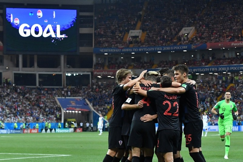 Croatia's forward Ivan Perisic (4) is congratulated by teammates after scoring his team's second goal during the Russia 2018 World Cup Group D football match in Rostov-On-Don on June 26, 2018. (AFP PHOTO)