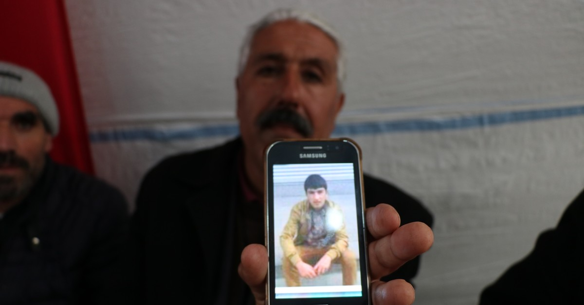 Father Melik Aslan holds a photo of his son Volkan Aslan who recently surrendered to security forces in southeastern Turkey (AA Photo)
