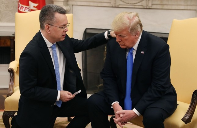 US President Donald Trump prays with American pastor Andrew Brunson in the Oval Office of the White House, Saturday October 13, 2018, in Washington. (AP Photo)