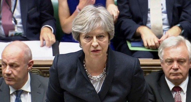 Britain's Prime Minister Theresa May addresses deputies in the House of Commons, London.
