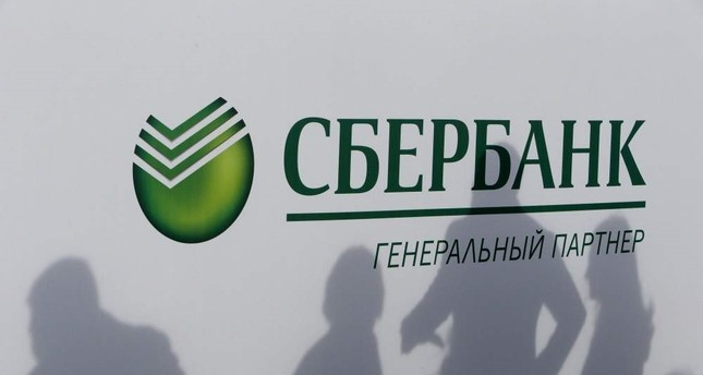 Participants cast their shadows on a board with the logo of Sberbank at the St. Petersburg International Economic Forum, Russia, June 1, 2017. Reuters Photo