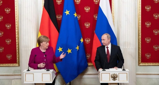 Russian President Vladimir Putin R  and German Chancellor Angela Merkel L attend their joint news conference after their talks in the Kremlin in Moscow, Russia, Saturday, Jan. 11, 2020. AP Photo