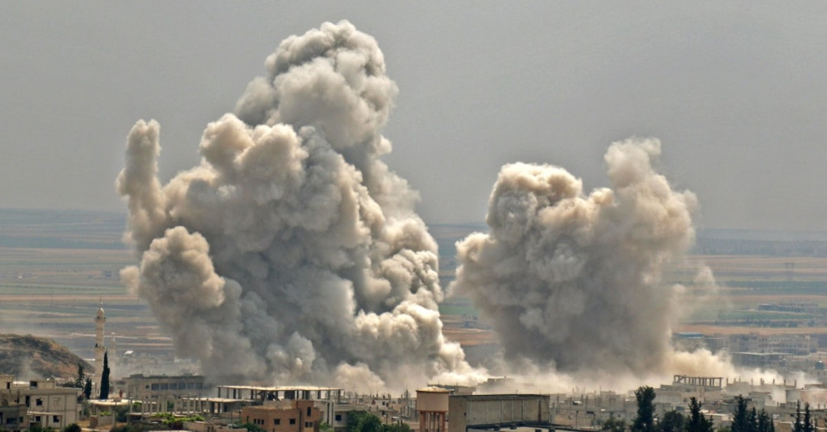 Plumes of smoke rise following reported Syrian regime forces' bombardment in Idlib province,  June 7, 2019.