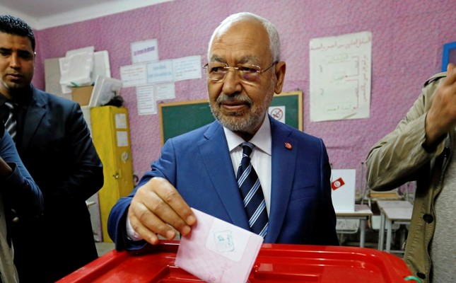 Rached Ghannouchi, the head of the Ennahda Party, casts his vote at a polling station for the municipal election, Tunis, May 6, 2018.