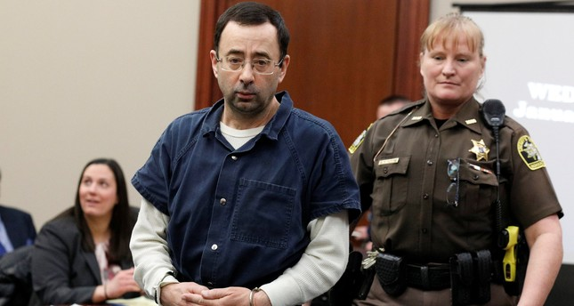 Larry Nassar, a former team USA Gymnastics doctor who pleaded guilty in November 2017 to sexual assault charges, is escorted by a court officer during his sentencing hearing in Lansing, Michigan, January 17, 2018. (REUTERS Photo)