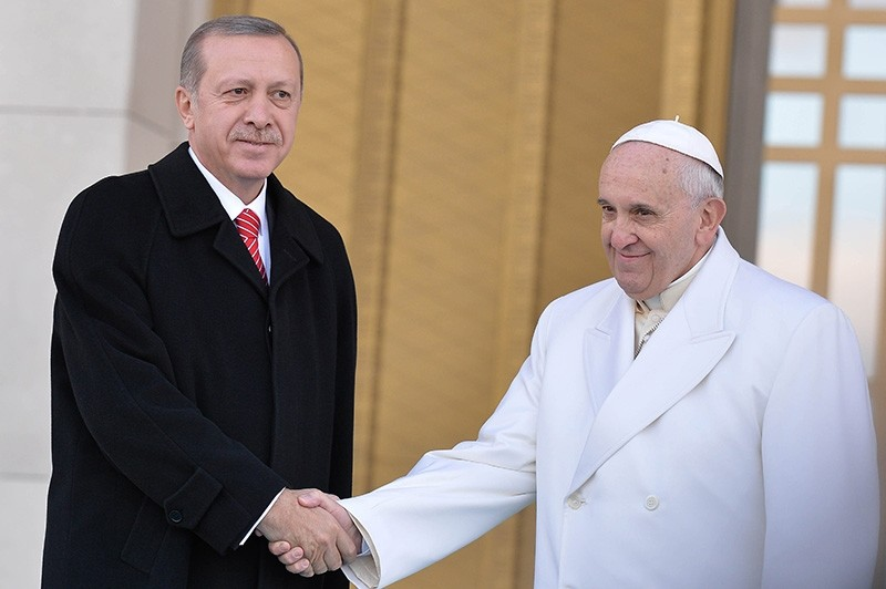 President Erdou011fan (left) shakes hands with Pope Francis at the Presidential Complex in Ankara in this undated photo (File Photo)