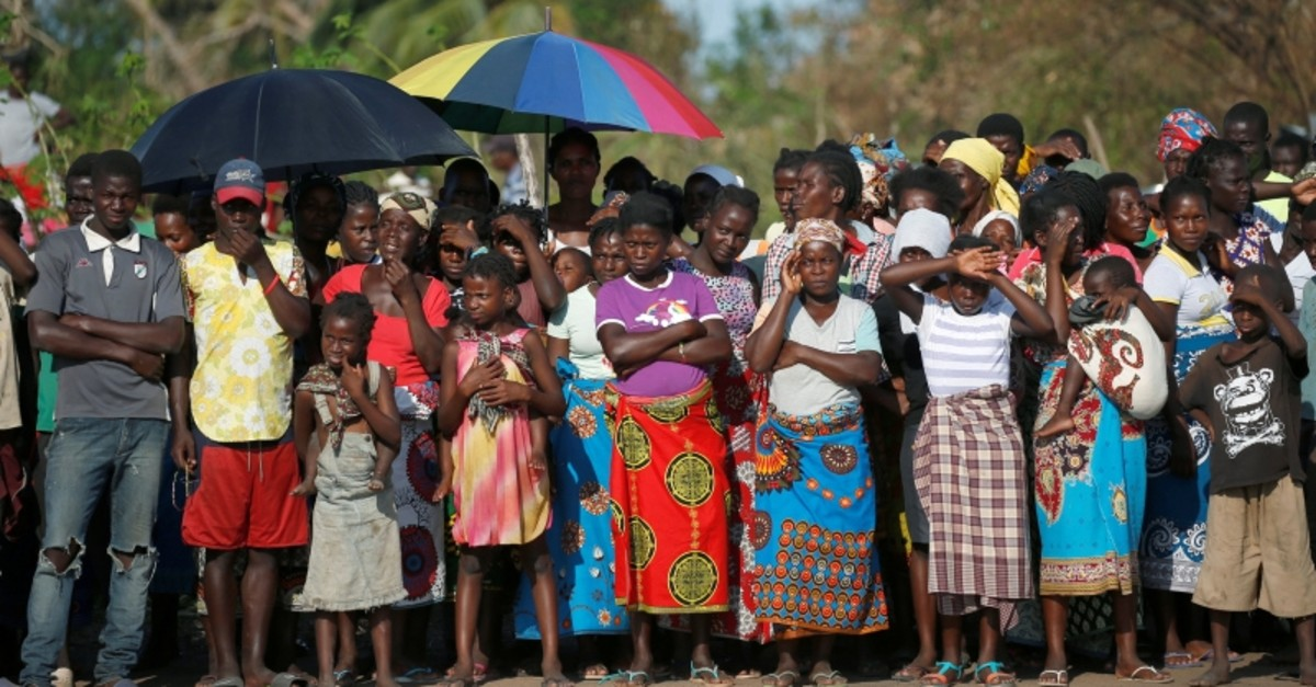 People look on as they wait for food aid in the aftermath of Cyclone Idai in Guara Guara village, near Beira, Mozambique, March 26, 2019. (Reuters Photo)