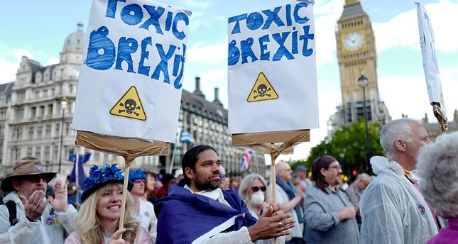 Demonstrators react in Parliament Square during the anti-Brexit 'People's March for Europe', in central London, Britain September 9, 2017. (Reuters Photo)