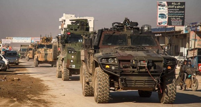 A Turkish military convoy of tanks and armoured vehicles passes through the Syrian town of Dana, east of the Turkish-Syrian border in the northwestern Syrian Idlib province, on February 2, 2020. AFP Photo