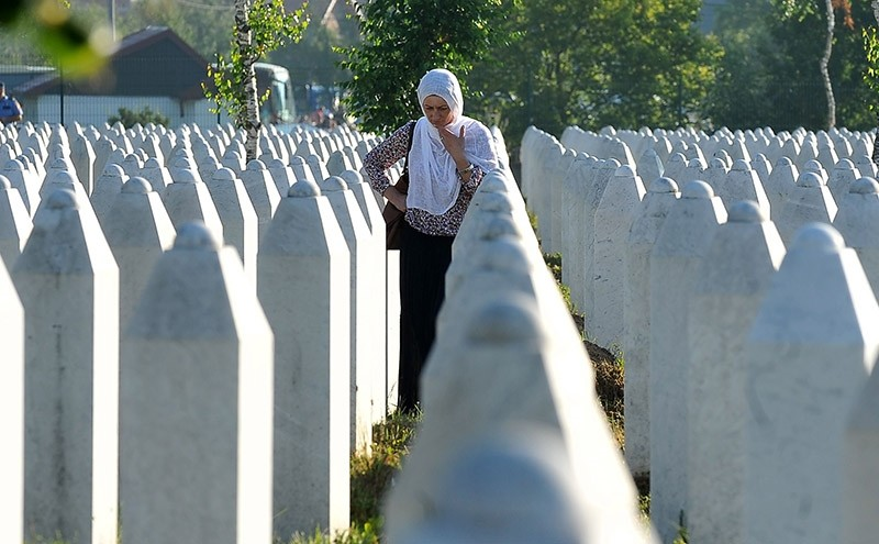 A Bosnian Muslim woman, survivor of Srebrenica 1995 massacre mourns near graves of her relatives, at memorial cemetery in village of Potocari, near Eastern-Bosnian town of Srebrenica. 2016. (AFP File Photo)