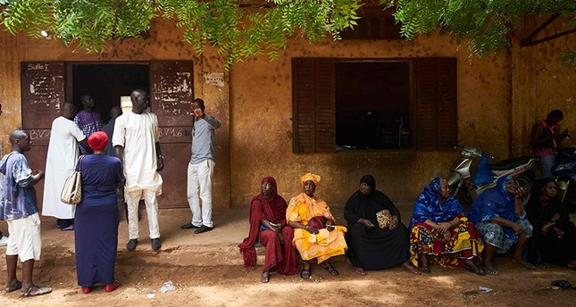 People queue outside to vote at a polling station in Bamako on Aug. 12, 2018 during the second round of Mali's presidential election. (AFP Photo)