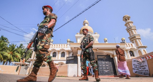 Sri Lankan military stand guard outside a mosque after clashes between two sectarian groups in a beachside resort in Poruthota village in Negombo, Sri Lanka May 6, 2019. Reuters Photo