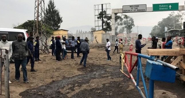 Congolese customs agents gather at the gate barriers at the border crossing point with Rwanda following its closure over Ebola threat in Goma, Democratic Republic of Congo, Aug. 1, 2019. (Reuters Photo)