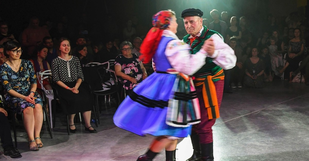 A Polish couple dressed in traditional costumes perform the countryu2019s mazurka folk dance in Warsaw.