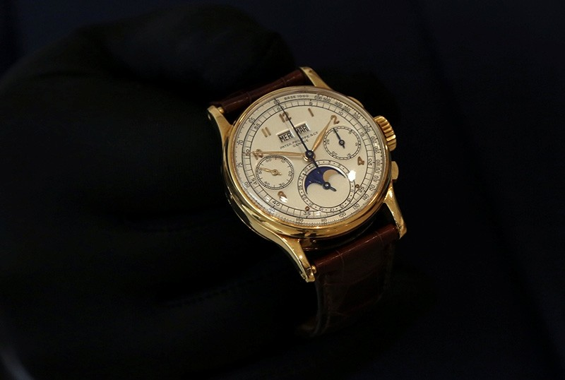The Patek Philippe 18k gold perpetual chronograph wrist watch with moon phases belonging to the King Farouk is on display at the Christie's auction in Dubai, United Arab Emirates, March 19, 2018 (Reuters Photo)