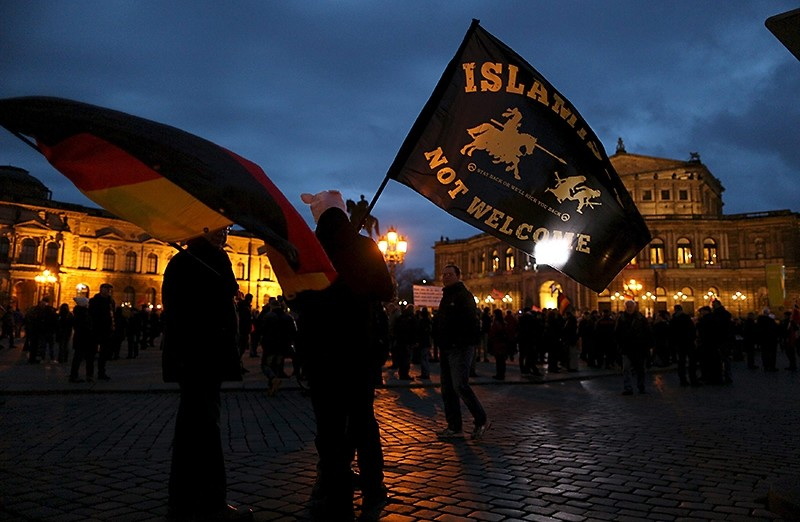 Supporters of the anti-Islam movement PEGIDA wave flags during a demonstration in Dresden, Germany.  (Reuters Photo)