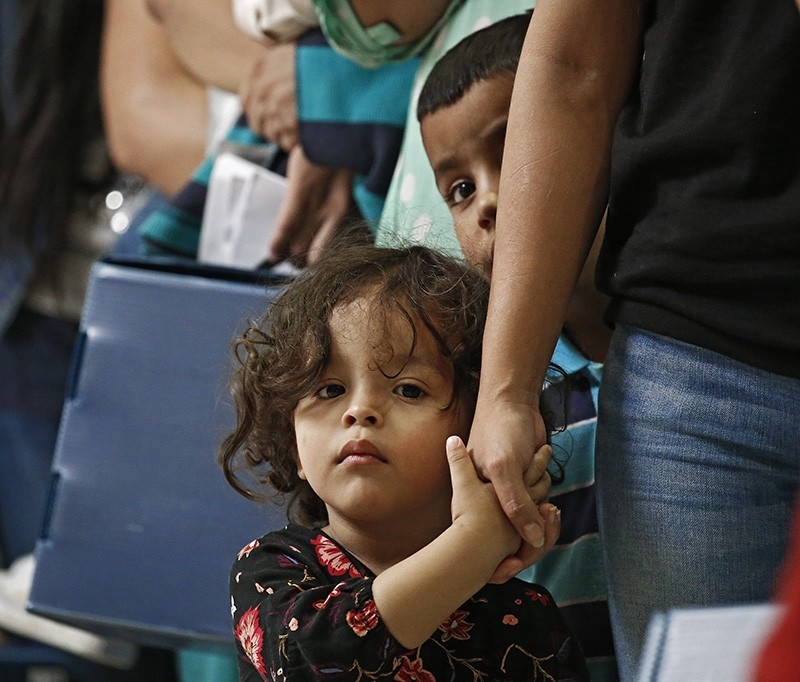 Migrant families are processed at the Central Bus Station before being taken to Catholic Charities before being removed in McAllen, Texas, USA, June 26, 2018. (EPA Photo)