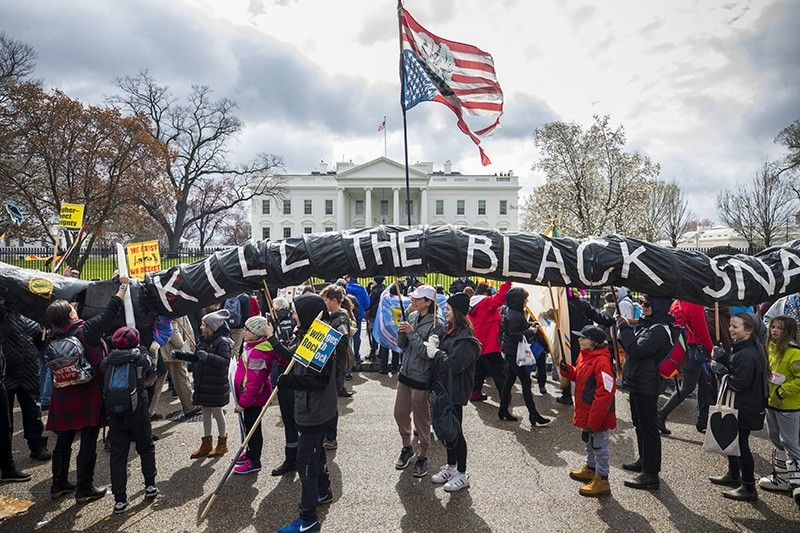 Protesters rally against President Donald J. Trump's support for the Dakota Access pipeline outside the White House in Washington, DC, U.S, March 10, 2017. The sign representing the pipeline reads: 'Kill the black snake.' (EPA Photo).
