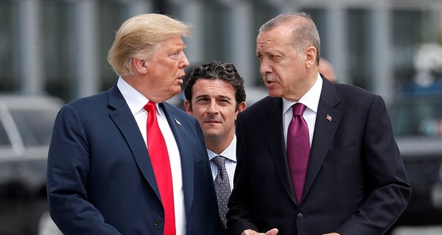 U.S. President Donald Trump and President Tayyip Erdoğan gesture as they talk at the start of the NATO summit in Brussels, Belgium July 11, 2018. (Reuters Photo)