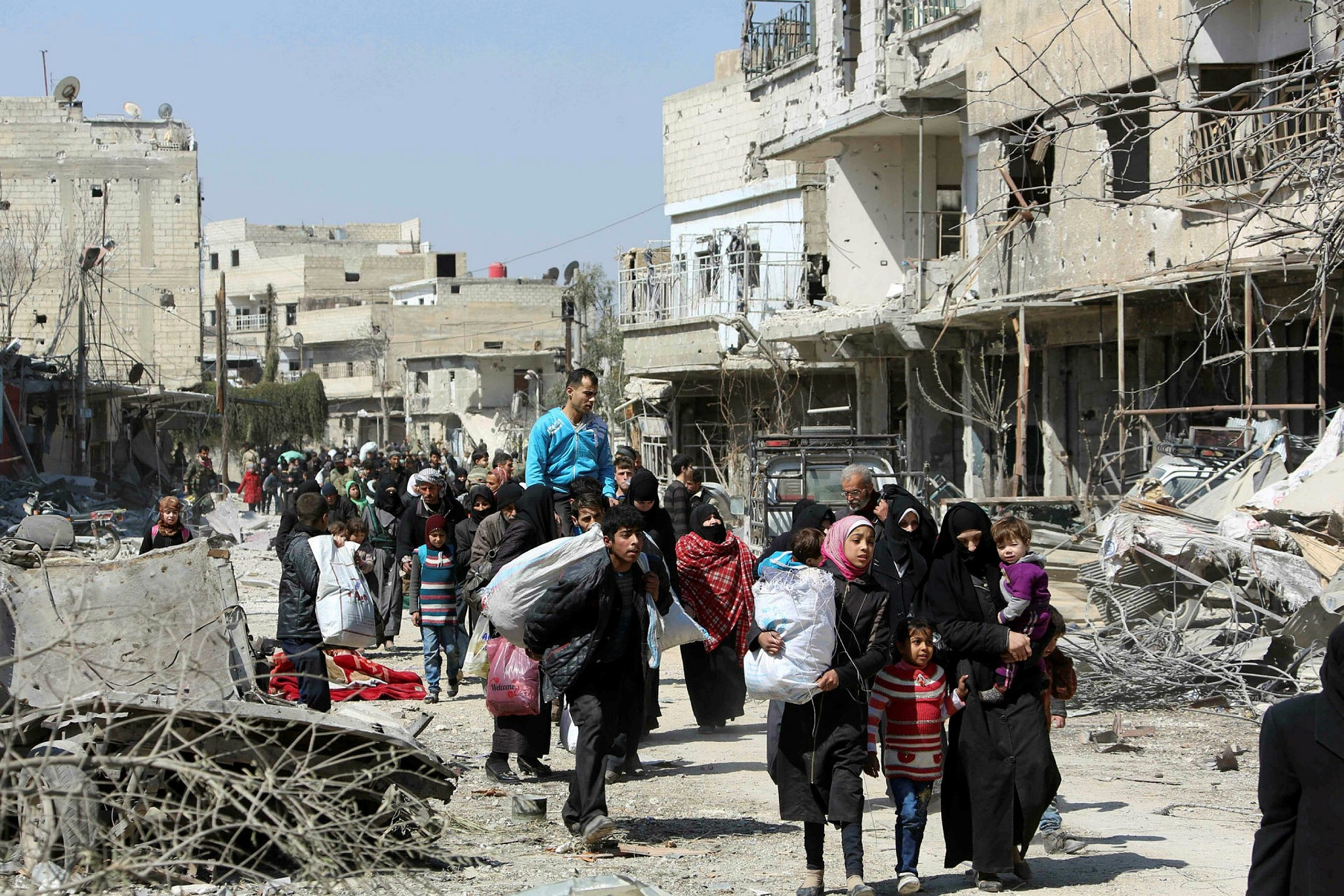 Syrian civilians evacuate the town of Jisreen in Eastern Ghouta, on the outskirts of the capital Damascus, to areas under government control, March 17.