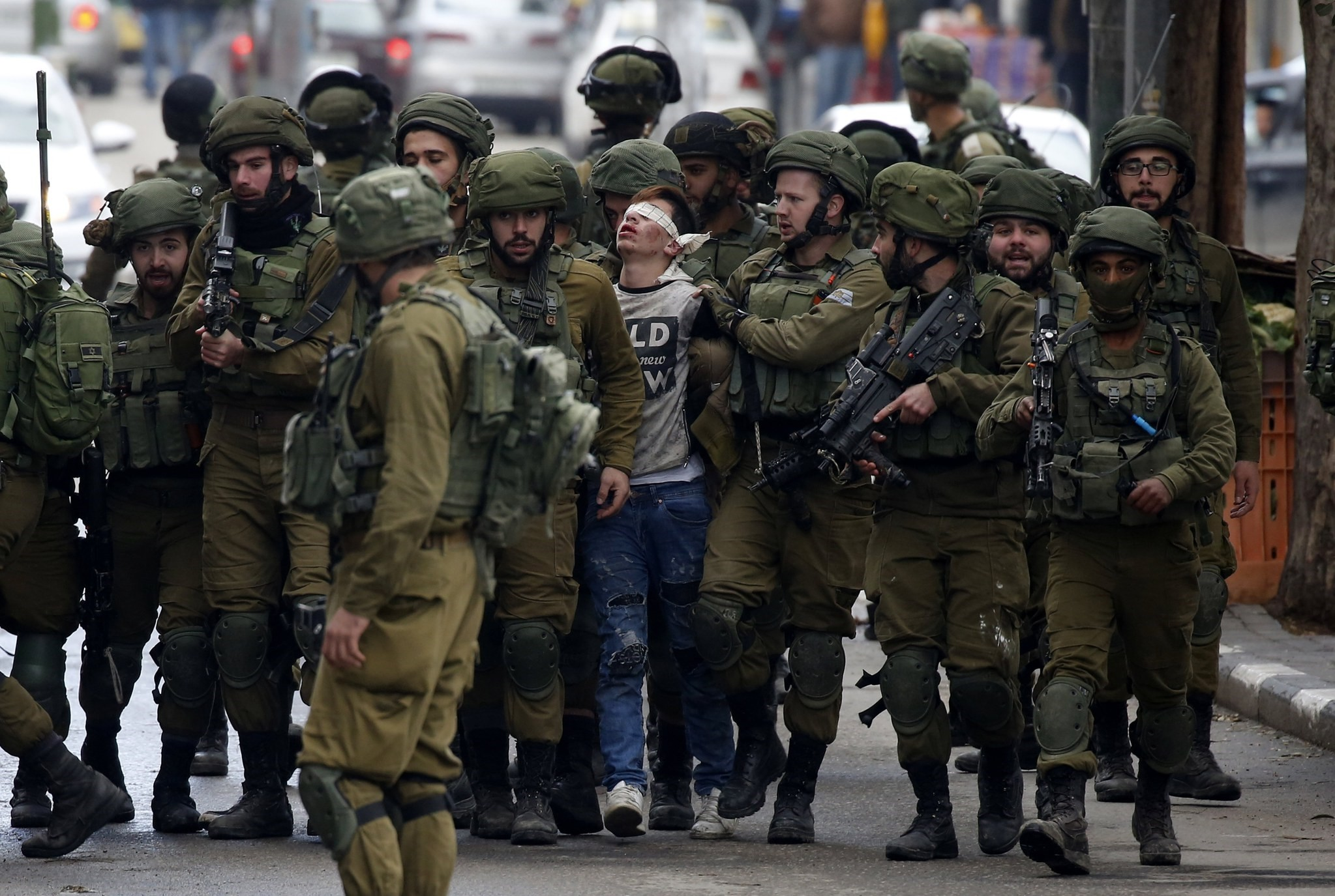Israeli forces detain a Palestinian boy in protests against a decision by Trump to recognise Jerusalem as the capital of Israel, in the West Bank city Hebron, 07 December 2017. (EPA Photo)