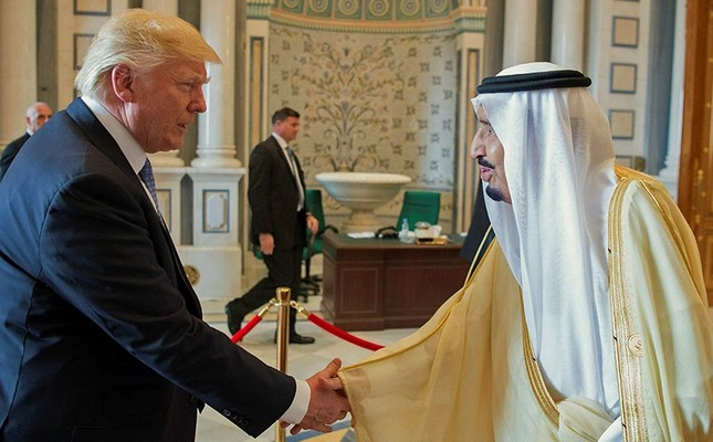 A handout photo made available by the Saudi Press Agency shows King Salman bin Abdulaziz al-Saud of Saudi Arabia (R), and U.S. President Donald Trump (L) shaking hands, Riyadh, Saudi Arabia, May 21, 2017.