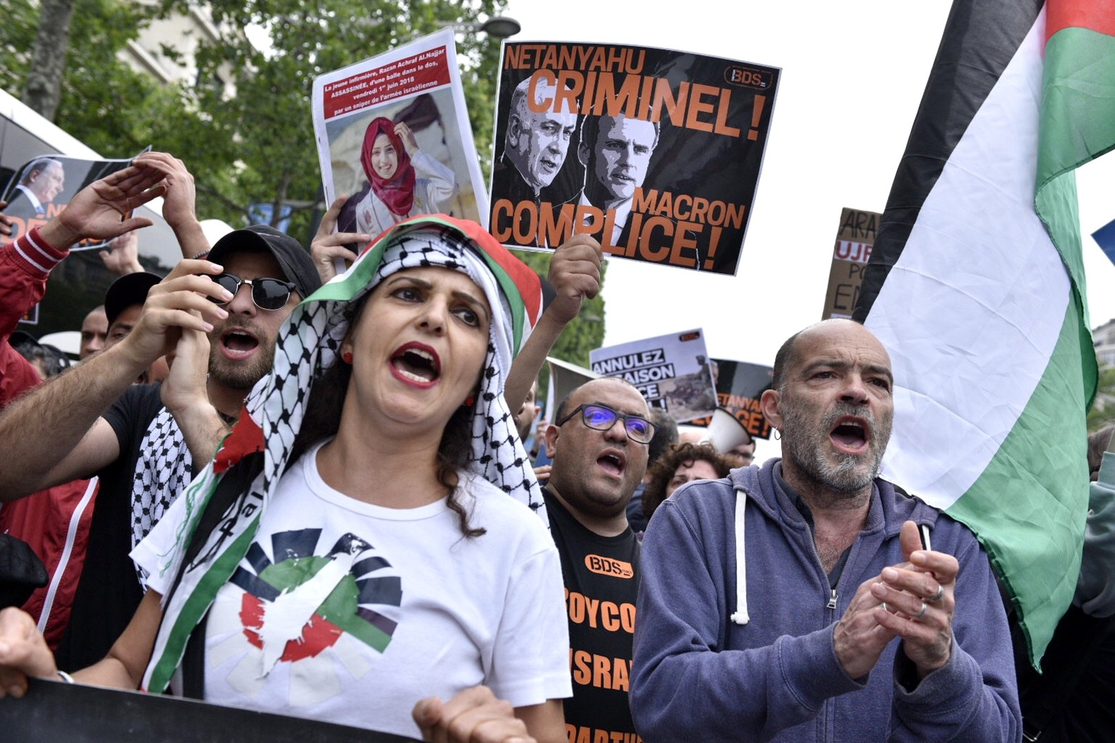 Protesters shout slogans against Netanyahu during a rally on the Champs Elysees avenue in Paris, June 5.