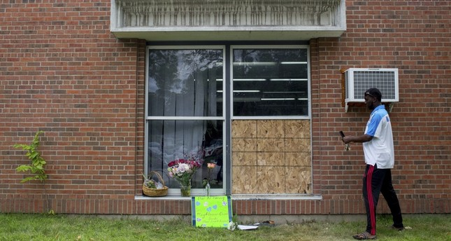 Abdul Mohamed photographs the damage outside of the Dar Al Farooq Islamic Center in Bloomington, Minnesota, Sunday, Aug. 6, 2017. (AP Photo)