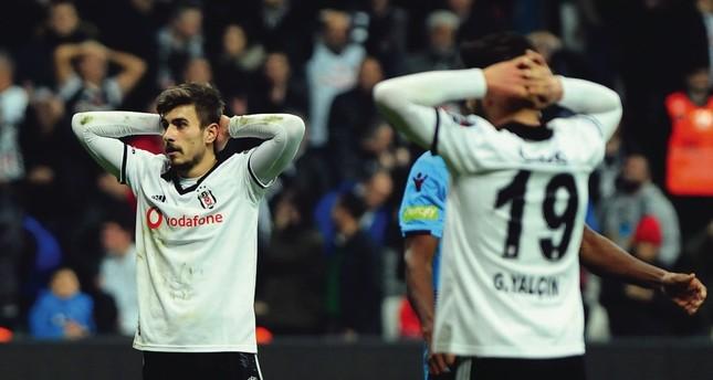 Beşiktaş' Güven Yalçın laments after a 2-2 draw with Trabzonspor on Sunday.