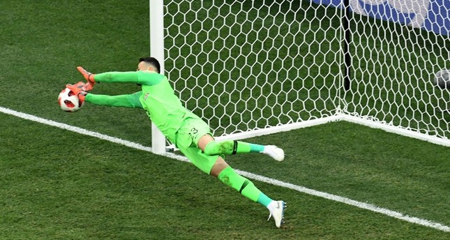 Croatia's Danijel Subasic saves a penalty from Denmark's Christian Eriksen, not pictured, during the penalty shootouts of the 2018 World Cup round of 16 match at the Nizhny Novgorod Stadium in Nizhny Novgorod, July 1, 2018. (AFP Photo)