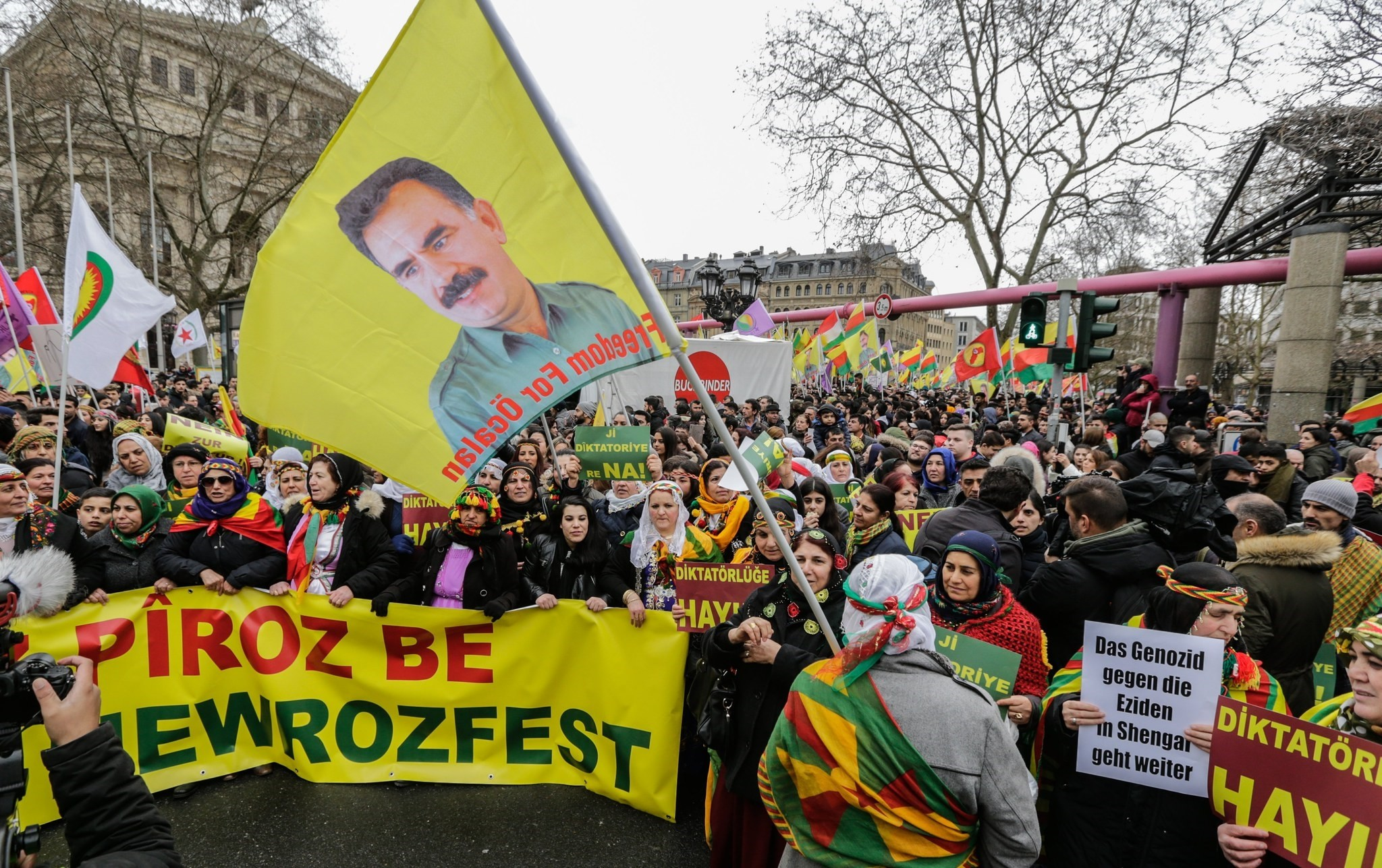 PKK followers carry a flag with a picture of terrorist groupu2019s leader and other banned posters and flags in Frankfurt, Germany. (EPA Photo)
