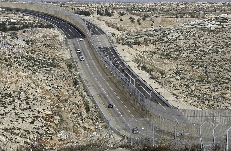 A newly opened segregated West Bank highway, right side of the wall, is seen near Jerusalem Thursday, Jan. 10, 2019. (AP Photo)