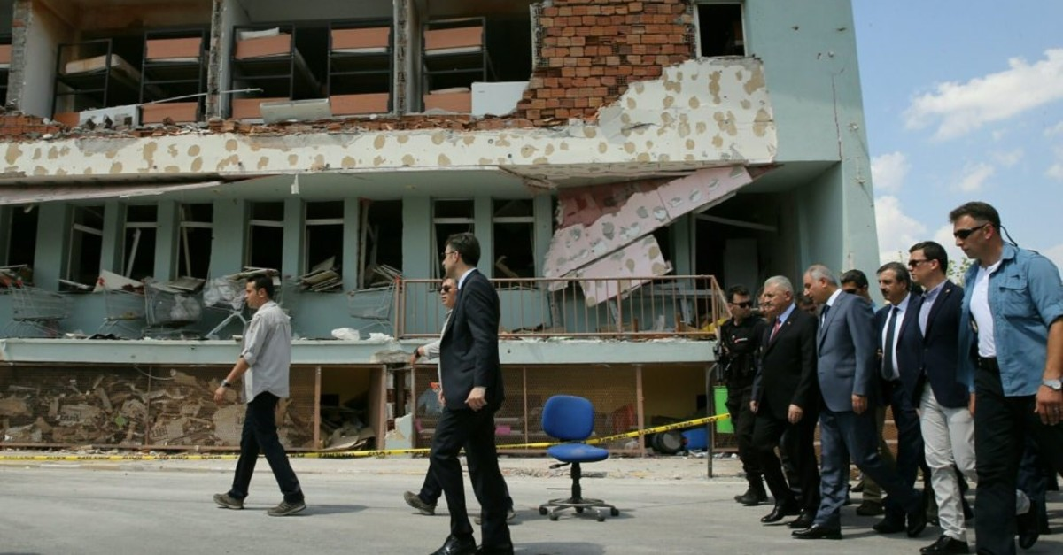 Then prime minister Binali Yu0131ldu0131ru0131m visits the bombed headquarters of Special Operations Unit of police in Ankara, July 22, 2016. Uu011fur Uzunou011flu who was behind the airstrike targeting the building, claimed he ,slept, during the coup attempt.