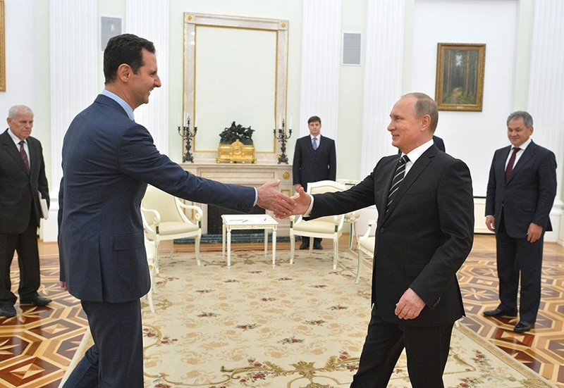 In this photo taken on Tuesday, Oct. 20, 2015, Russian President Vladimir Putin, right, shakes hand with Syrian President Bashar Assad in the Kremlin in Moscow, Russia. (AP Photo)