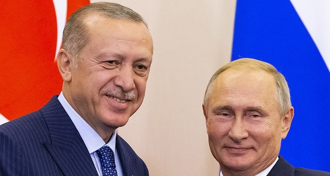 President Recep Tayyip Erdoğan (L) and Russian President Vladimir Putin (R) shake hands after their joint news conference following the talks in the Bocharov Ruchei residence in the Black Sea resort of Sochi, Russia, Sept. 17, 2018. (EPA Photo)