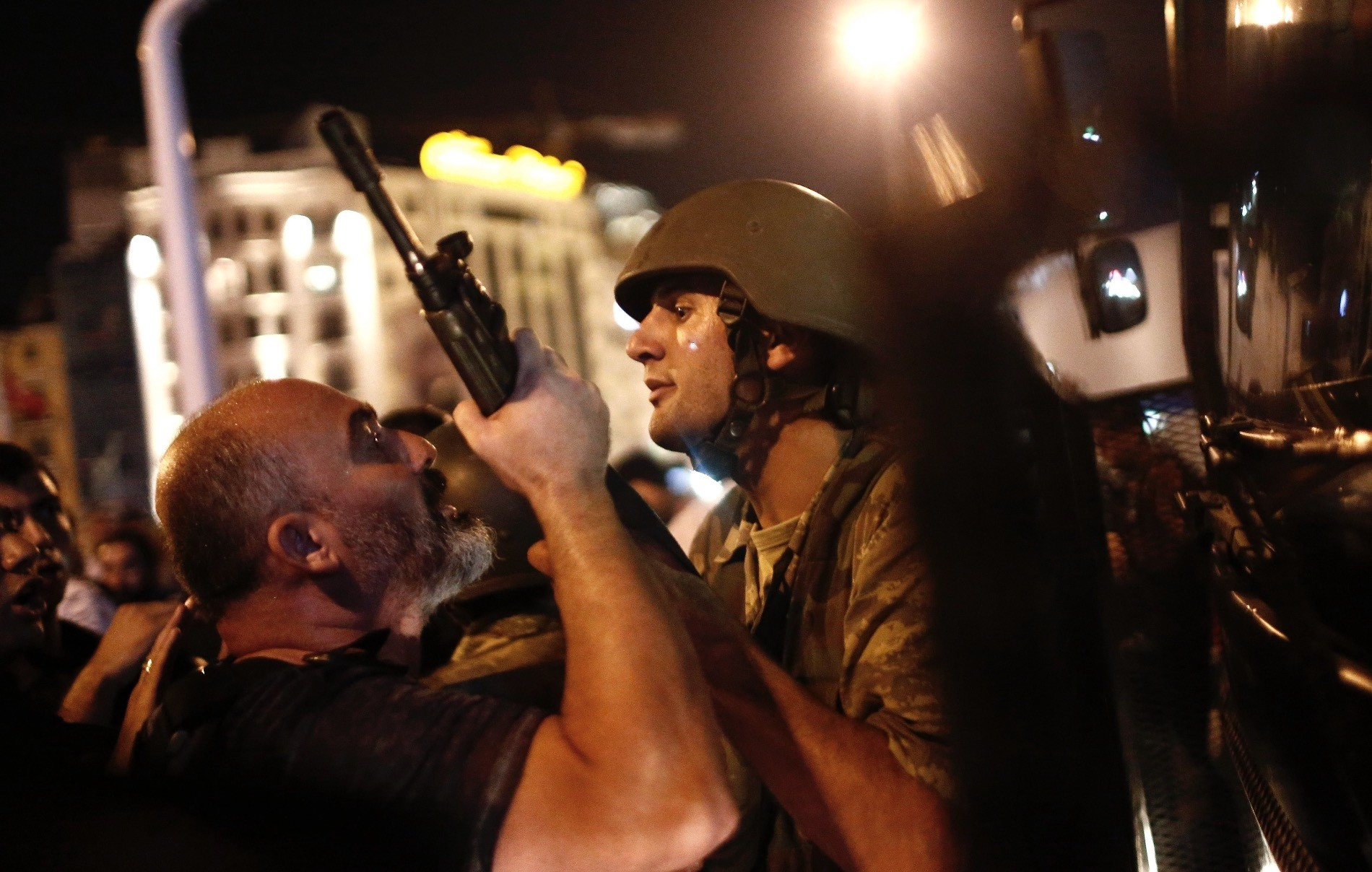 A man resisting a coup officer as the July 15 coup attempt perpetrated by FETu00d6 wasn't repelled yet, Taksim Square, Istanbul.