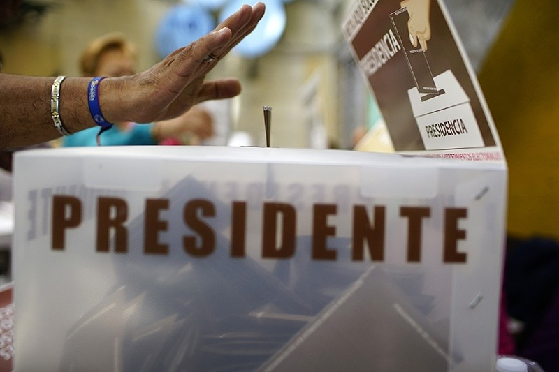 A voter casts his ballot at a polling station during the presidential election in Mexico City, Mexico, July 1, 2018. (Reuters Photo)