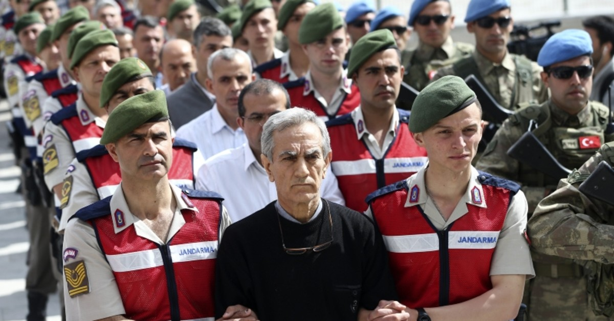 This file photo shows the defendants of the main coup attempt trial, with former Air Force Commander Gen. Aku0131n u00d6ztu00fcrk in the forefront, being brought to the courthouse in Sincan Prison Complex.