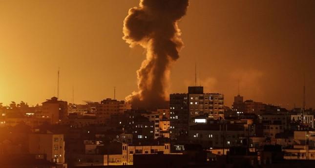 Smoke rises above the building housing the Hamas-run television station al-Aqsa TV in the Gaza Strip during an Israeli air strike, Nov. 12.