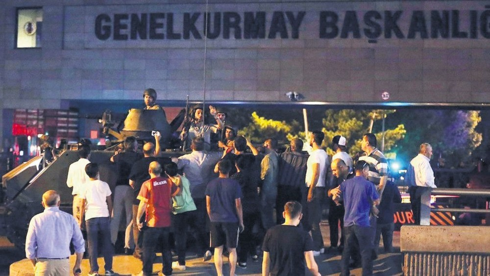 People opposing the putsch confront pro-coup troops outside the headquarters of the Chief of General Staff in the capital Ankara. Several people were killed inside and outside the building when putschists opened fire.