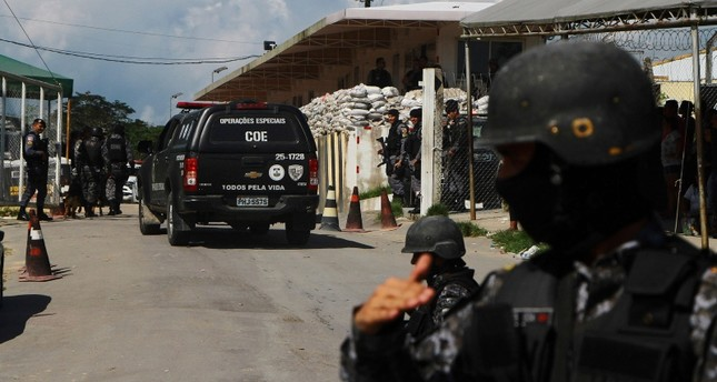 Police guard the entrance to the Anisio Jobim Prison Complex after a deadly riot erupted among inmates in Manaus in the northern state of Amazonas, Brazil, Sunday, May 26, 2019. (AP File Photo)
