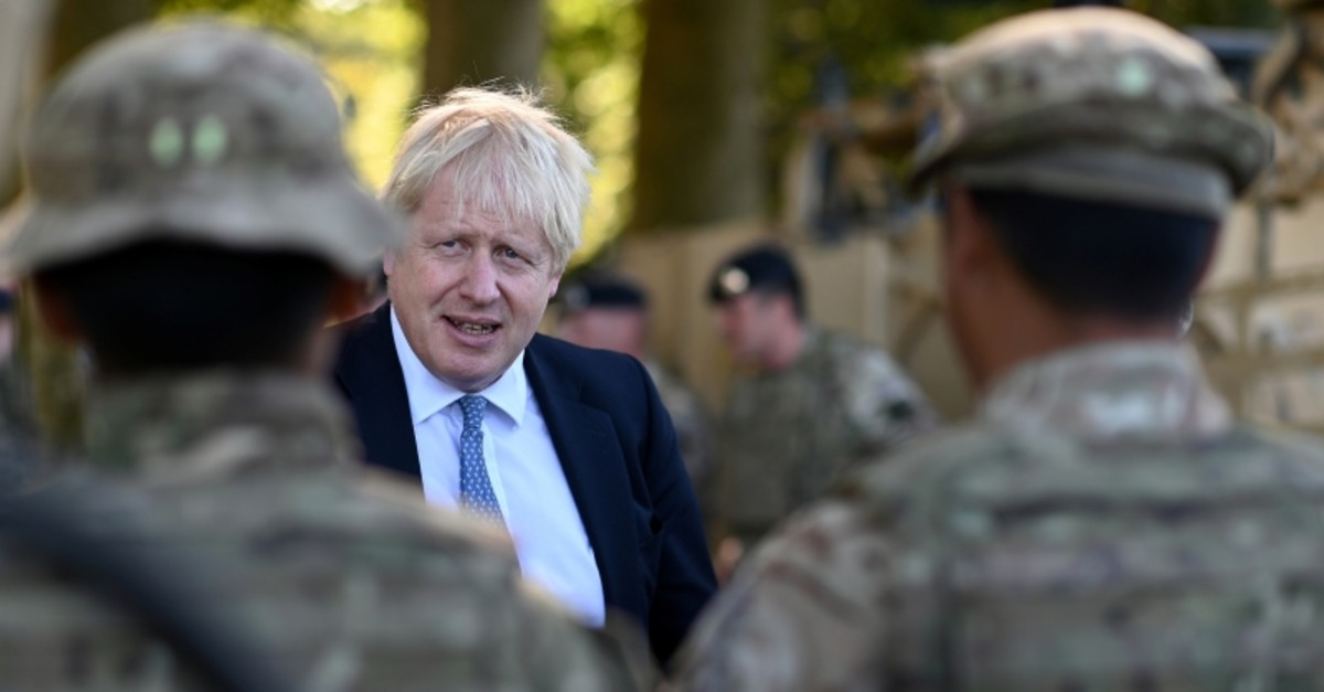 Britain's Prime Minister Boris Johnson chats with Ghurkas during a visit to military personnel on Salisbury plain training area near Salisbury, Britain September 19, 2019. (Reuters Photo)